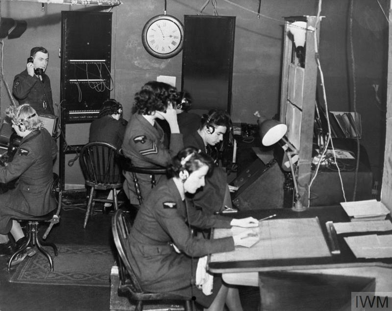 Chain Home: airmen and WAAF operators at work in the wooden Receiver hut at Ventnor CH, Isle of Wight, during the Battle of Britain.