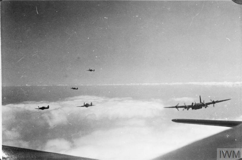 Short Stirling Mark Is of No. 15 Squadron RAF, meet up with their fighter escort of Hawker Hurricanes over the south-eastern coast of England, on a 'Circus' operation to bomb a target in Lille, France. Photograph taken from the mid-upper turret of one of the three participating Stirlings.