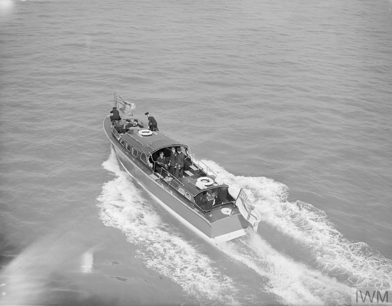THE KING WITH THE INVASION FLEET. 24 MAY 1944, HMS BULOLO, AT BEAULIEU ROADS. THE KING VISITED MEN OF THE INVASION FLEET ON BOARD THE HEADQUARTERS SHIP HMS BULOLO.