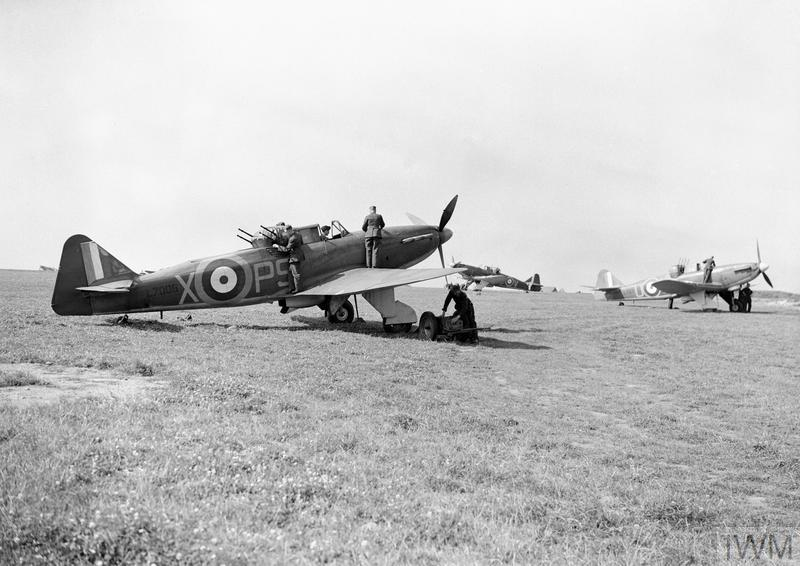 Boulton Paul Defiant Mark Is (L7006 'PS-X' nearest) of No. 264 Squadron RAF, being prepared for take off by groundcrew at Kirton-in-Lindsey, Lincolnshire.