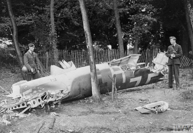 Men of the RAF guard the remains of a Dornier Do 17 shot down during the attack on Kenley aerodrome, 18 August 1940.