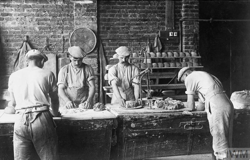 Bread is made in a German Army field bakery at Wervicq in Flanders, 1916.