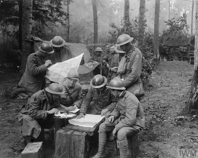 Officers of the 2/4th Battalion, King's Own Yorkshire Light Infantry, 62nd Division, conferring with French and Italian officers in the Bois de Reims during the Battle of Tardenois, 24 July 1918. © IWM (Q 11113)