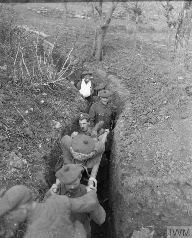 Casualties from a Scottish infantry battalion of 77th Brigade being evacuated along a communication trench in the 'Birdcage' Line outside Salonika, February 1916.