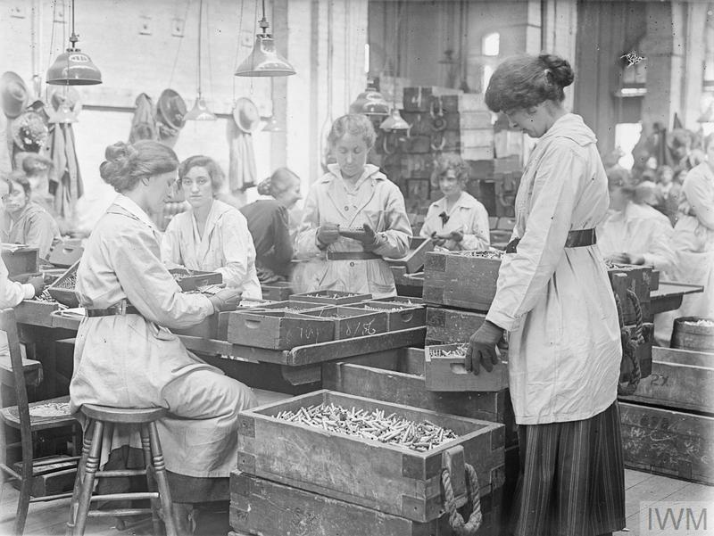 Female workers inspect Small Arms Ammunition (SAA) in an SAA Factory of the Royal Laboratory at the Royal Arsenal, Woolwich, London, in May 1918.