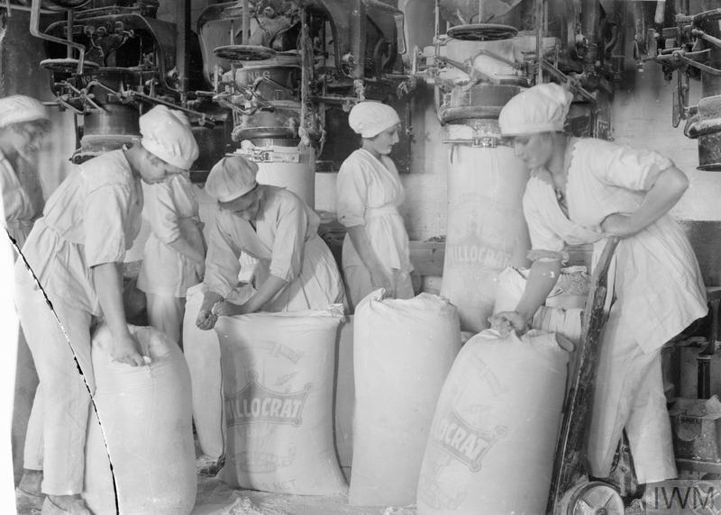 Female workers pack flour in a mill at the works of Rank and Sons, Birkenhead, September 1918.