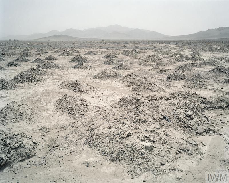 In 2002, IWM commissioned Paul Seawright to respond to the War in Afghanistan. He was interested in how an artist might engage with conflict in a way that was different to the dramatic spectacles of photojournalism. The resulting photographs of minefields show a seemingly empty landscape, which in reality is both lethal and inaccessible. He says that he had'always been fascinated by the invisible, the unseen, the subject matter that doesn't easily present itself to the camera.