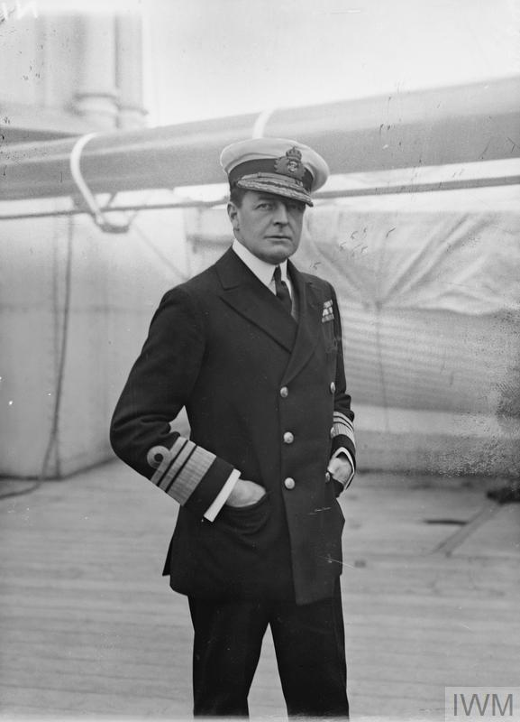 Admiral Sir David Beatty poses for journalists on board a ship. Note the trademark tilt of his cap.