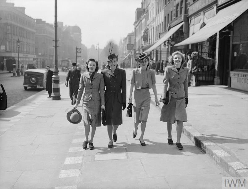 Women walk down a London street during the Second World War in 1941.