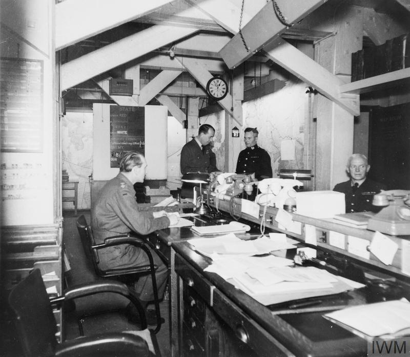 THE MAP ROOM OF THE CABINET WAR ROOMS IN USE, 1945.
