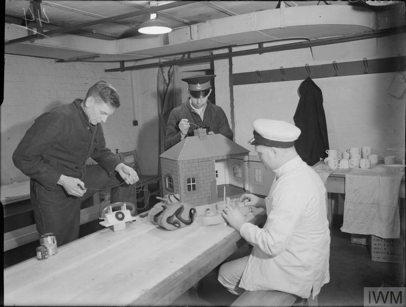 CHRISTMAS TOYS FROM SCRAP WOOD. 25 NOVEMBER 1943, DERBY HOUSE, LIVERPOOL. MARINES AND NAVAL RATINGS MAKE CHRISTMAS TOYS FROM SCRAP WOOD.