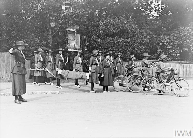 Girl Guides with a stretcher and other equipment in preparation for post-air raid emergency help in the United Kingdom during the First World War.