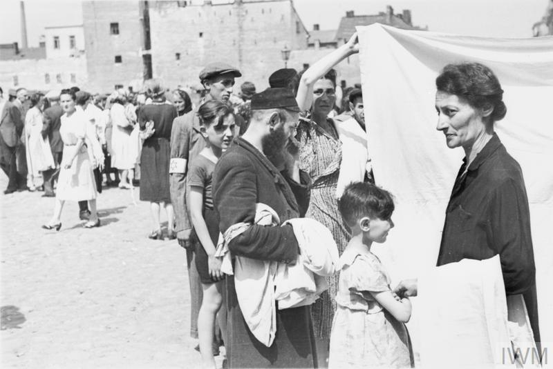 Jewish residents shopping in a street market in the ghetto.