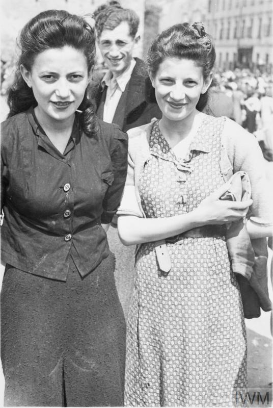 Two well dressed women, most likely sisters, posing for a photograph in a street market in the ghetto, summer 1941.