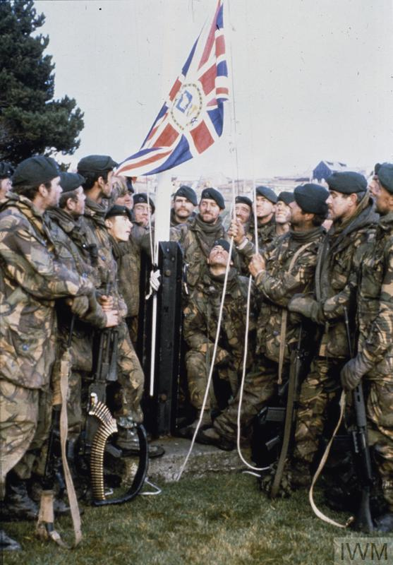 ROYAL MARINE COMMANDOS WITH THE FLAG OF THE GOVERNOR OF THE