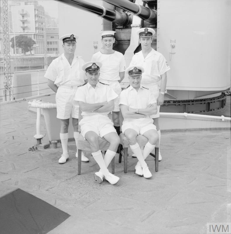 GALLANTRY AWARDS FOR HMS DIANA'S FIRE FIGHTERS. DECEMBER 1968, ON BOARD HMS DIANA IN HONG KONG. TWO OFFICERS AND THREE RATINGS OF HMS DIANA WERE AWARDED FOR THEIR BRAVERY IN FIGHTING A FIRE ABOARD THE SPANISH TANKER BAHIA GADITANA IN THE MEDITERRANEAN, WEST OF CRETE. THE TWO OFFICERS WERE AWARDED THE MBE AND THE RATINGS THE BEM.