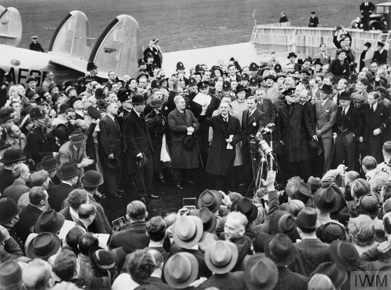 Neville Chamberlain arrives in England and announces 'peace in our time' after his meeting with Hitler at Munich.