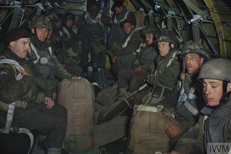 British paratroopers sitting in the fuselage of an aircraft while awaiting their order to jump.