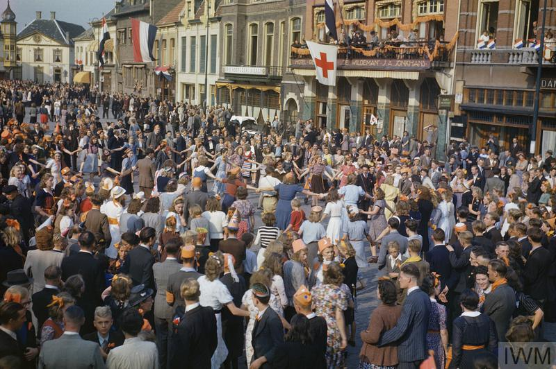 Dutch civilians dance in the streets after the liberation of Eindhoven by the US 101st Airborne Division, 18 September 1944.