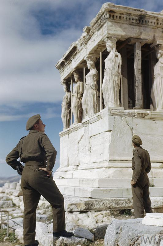 Sergeant R Gregory and Driver A Hardman admire the Caryatids during a tour of the Acropolis in Athens.