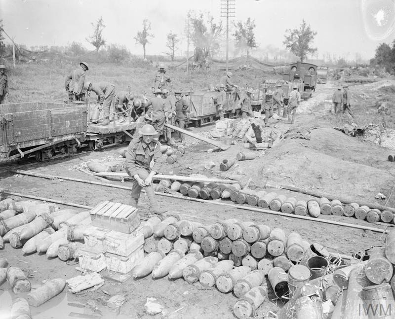 Gunners of the Royal Garrison Artillery unloading shells from a light railway train at Brielen, 3 August 1917.