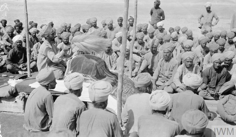 Sikh infantrymen attending a Diwan on campaign in the deserts of Mesopotamia in 1918