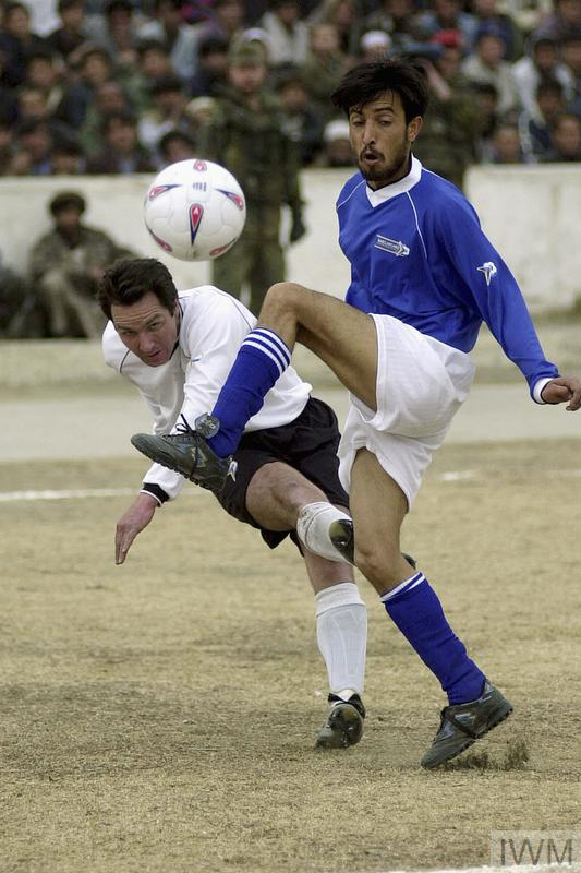 A football match between a local team, Kabul United and ISAF is watched by 30,000 spectators at the Olympic Stadium in Kabul, 15 February 2002. The match was the first international sporting event to take place in Afghanistan in five years. The Taliban regime had used the stadium for public executions. Corporal Giacomo Ligouri, Italian Army, ISAF team, levels the score. ISAF eventually won the match by 3 goals to one.