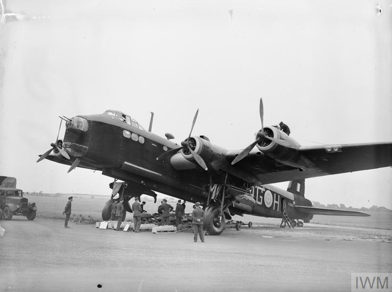 Stirling N3663/MG-H of No 7 Squadron, on display at Newmarket Heath, Suffolk, during a visit by King Peter of Yugoslavia, 29 July 1941. A typical bomb load is on view beneath the aircraft for the King's inspection.
