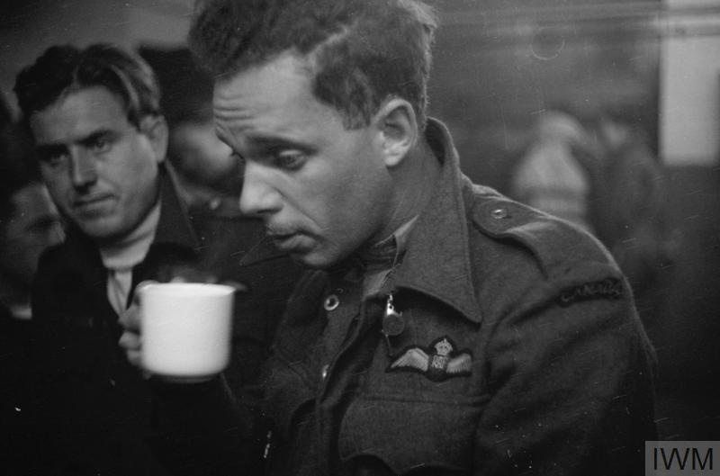 Tiredness etched on the face of a young Halifax pilot of No 405 (Vancouver) Squadron, RCAF, after returning from an operation over Germany, July/August 1942.