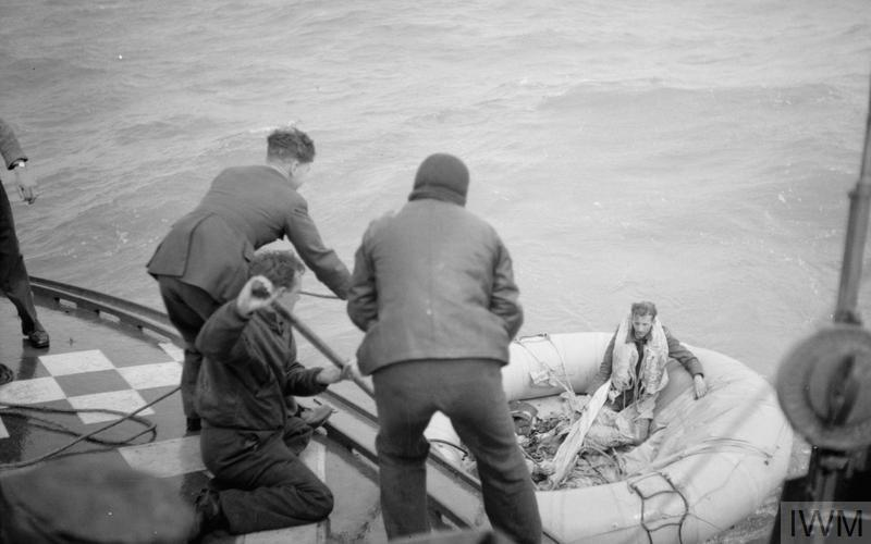 The crew of an RAF Air/Sea Rescue launch haul in a dinghy with two exhausted survivors from a No 166 Squadron Wellington, HE862/AS-L, which ditched off the French coast after developing engine trouble on its way to Mannheim on 16 April 1943. Flying Officer R Lord (facing camera) and Flying Officer E Hadingham (out of sight) drifted for five days before being picked up. They survived on rainwater, 18 Horlicks tablets and a bar of chocolate between them.