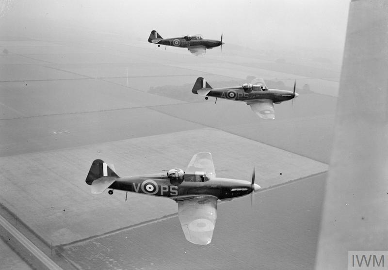 Three Boulton Paul Defiants of No. 264 Squadron fly in a 'vic' formation, August 1940.
