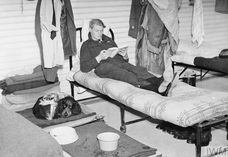 Flying Officer Frank Brinsden of No. 19 Squadron lays on his bed in the pilots' quarters at Fowlmere, September 1940.