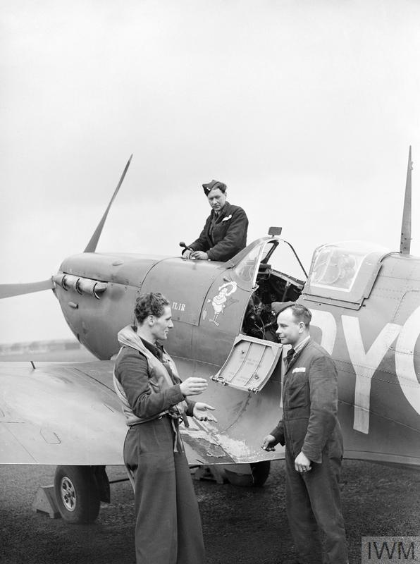 A Czech Spitfire pilot of No 313 Squadron in conversation with his rigger and fitter at Hornchurch, 8 April 1942. His aircraft is BL581 Moesi-llir, a Mk VB presented by the Netherlands East Indies Fund.