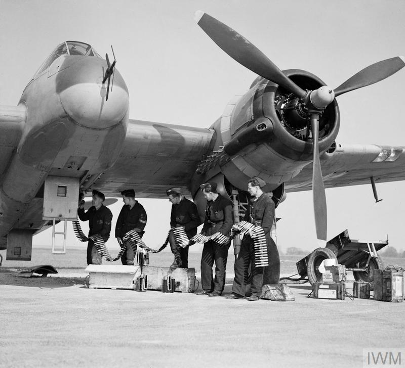 Beaufighter VIF V8748/ZJ-R of No 96 Squadron being re-armed at Honily, 23 March 1943. The armourers are feeding belts of ball and high-explosive incendiary ammunition into the magazines of the aircraft's four 20mm Hispano cannon.