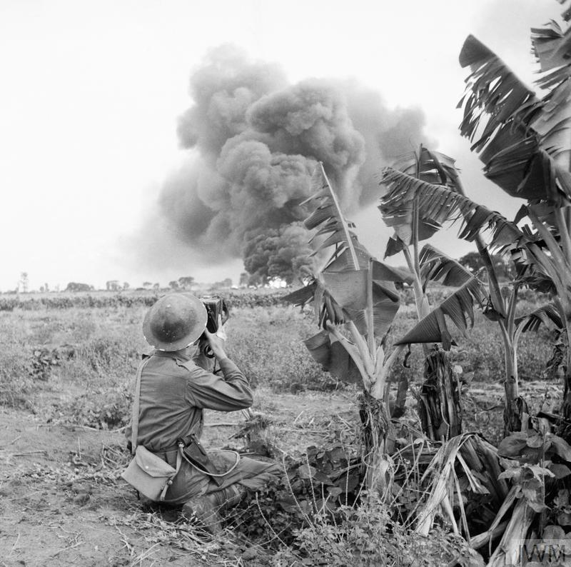AFPU photographer Sergeant E.E. Miller in action with the 5th Indian Division during the drive on the Rangoon