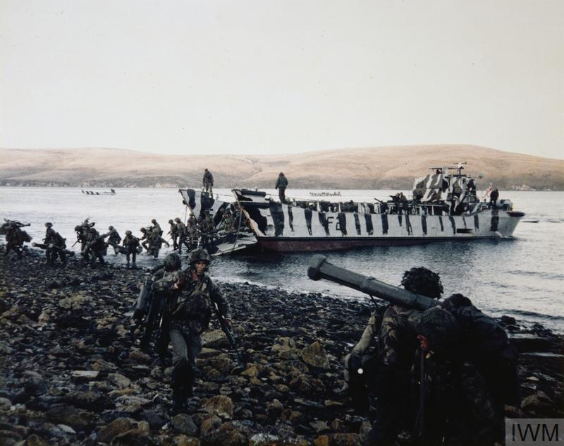 Men of 3rd Battalion, the Parachute Regiment disembark from a landing craft during the landings at San Carlos.