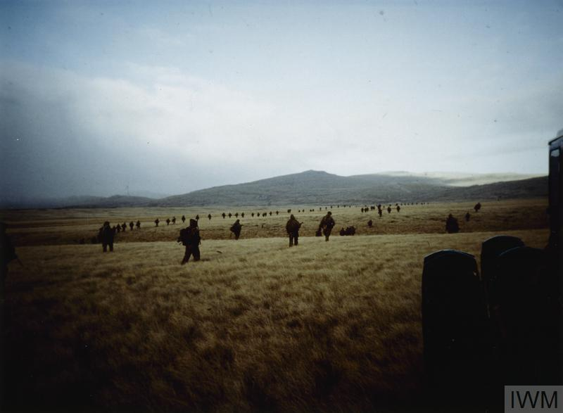 Men of 3rd Battalion, the Parachute Regiment advance across open country from Teal Inlet towards Estancia House on 30 May 1982.