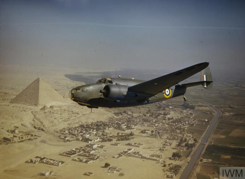 A Royal Air Force Lockheed Hudson Mk VI (AE626) aircraft of the Middle East Communications Flight flying over the pyramids.