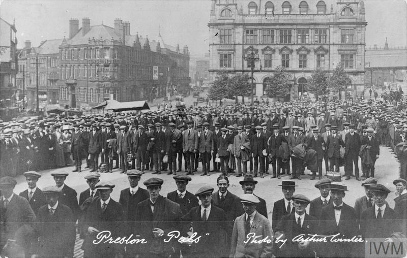 "The ""Preston Pals"". Volunteer recruits for a service battalion in civilian clothes, drawn up outside Preston Town Hall during the early months of the First World War."