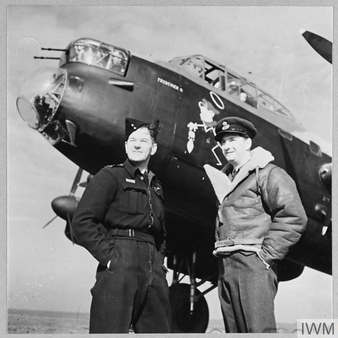 Wing Commander Hopcroft stands beside his Lancaster with his observer from No. 57 Squadron