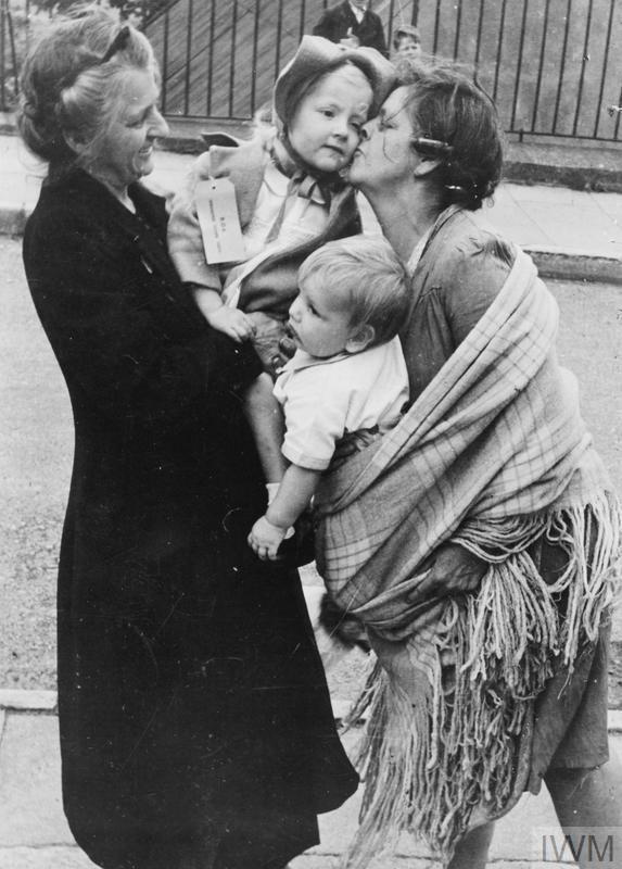 Evacuees return home to London. Photo shows villagers saying goodbye to the children they adopted for the war.
