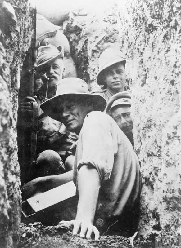 Infantrymen and lighthorsemen in a trench on the Gallipoli Peninsula. The lighthorseman on the left at the back who is smoking a pipe is 211 Trooper Andrew Powell Yeates, 9th Light Horse, aged 54, father to the soldier in the foreground, his son 1103 Private James August Yeates, 3rd Australian General Hospital (AGH). Both men enlisted in 1914.
