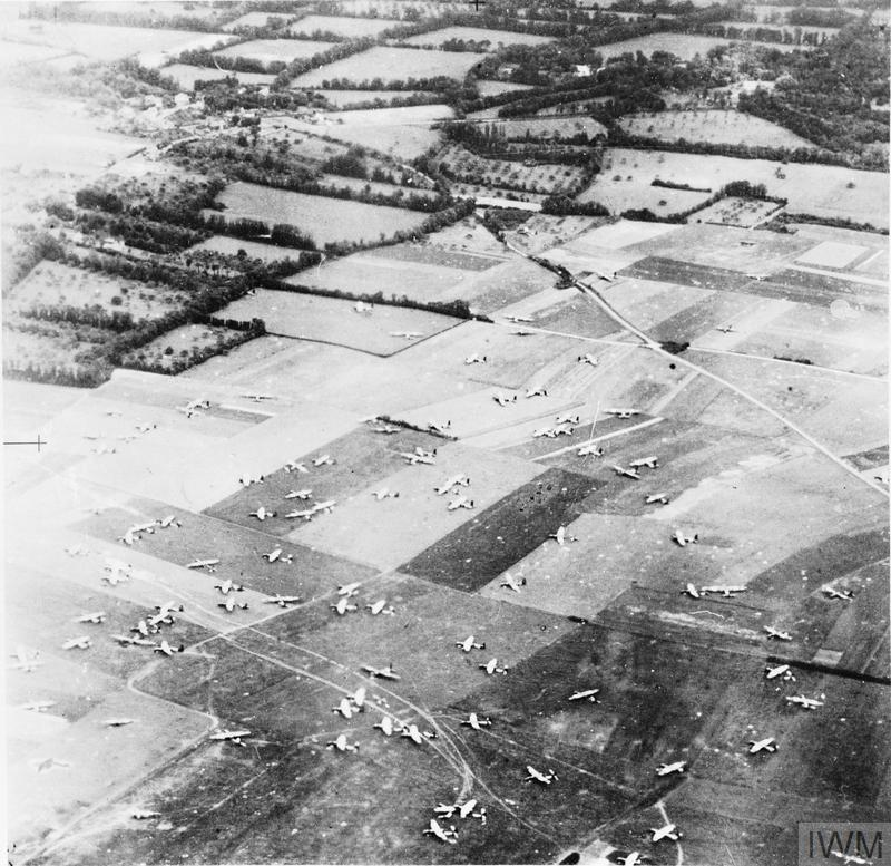 Oblique aerial photograph of part of 6th Airborne Division's Drop Zone 'N' between Ranville and Amfreville, east of the Orne River, 6 June 1944. Airspeed Horsa gliders can be seen on the DZ, many with their fuselages separated for ease of unloading. The villages of Amfreville and Breville can be seen in the top left of the photograph.