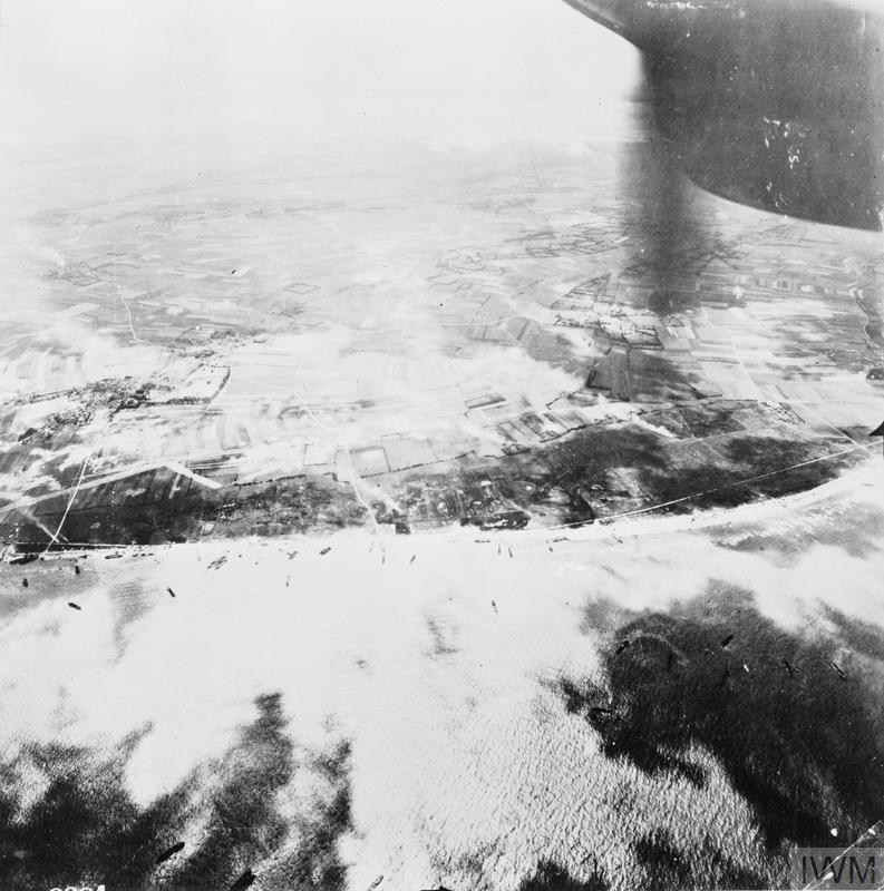Aerial oblique photo of Gold assault area during the landing of 50th Infantry Division, showing King Red (left), King Green and Jig Red (right) beaches, 6 June 1944. A German anti-tank ditch is visible on the left in front of the village of Ver-sur-Mer.