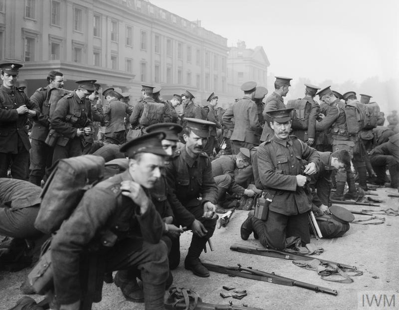 1st Battalion, Irish Guards prepare to leave Wellington Barracks, Westminster, London, following the outbreak of the First World War, 6 August 1914. © IWM (Q 66157)