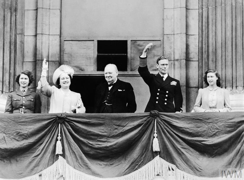 HM King George VI and Queen Elizabeth with Princess Elizabeth and Princess Margaret joined by the Prime Minister, Winston Churchill on the balcony of Buckingham Palace, London on VE Day.