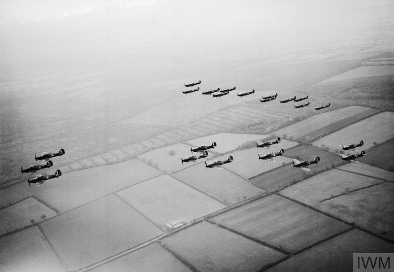 A formation of Hawker Hurricanes of No. 1 Squadron RAF lead Supermarine Spitfires of No. 266 Squadron during a flying display for aircraft factory workers, .