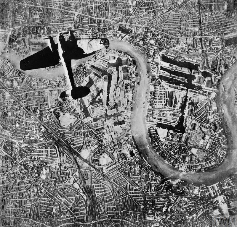 A German Heinkel He 111 bomber flying over the Isle of Dogs in the East End of London at the start of the Luftwaffe's evening raids on 7 September 1940, the first day of the Blitz.