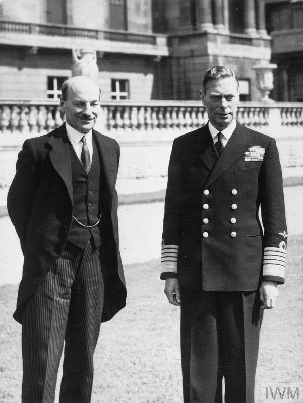 The 1945 General Election: King George VI standing with the Labour Prime Minister, Clement Attlee, in the grounds of Buckingham Palace, London.