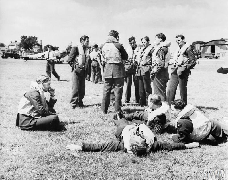 Spitfire pilots of No. 610 Squadron RAF relax between missions.